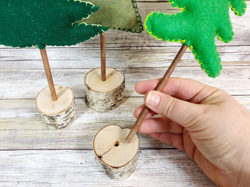 Insert wooden dowel into tree branch base Poly-Fil from Fairfield World Creatively Beth #creativelybeth #polyfil #fairfieldworld #christmasinjuly #manteldecor