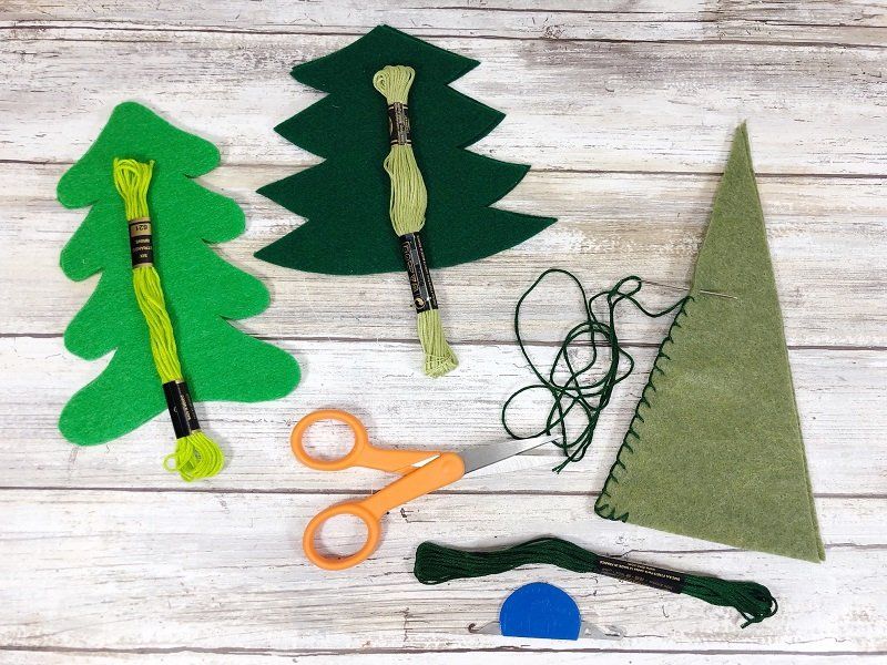 Sew two tree shapes together with embroidery floss Poly-Fil from Fairfield World Creatively Beth #creativelybeth #polyfil #fairfieldworld #christmasinjuly #manteldecor