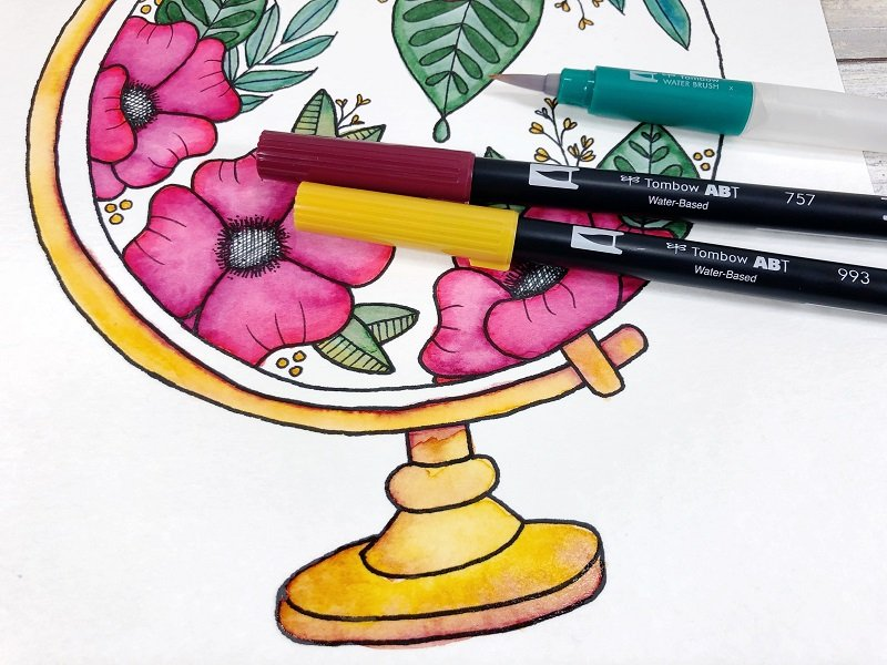 Add yellow and burgundy to create a brassy tone for the globe frame Creatively Beth #creativelybeth #freeprintable #handdrawn #watercolor #tombowdualbrushpens