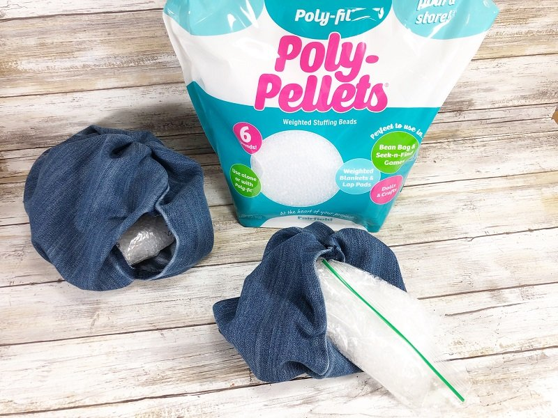 Insert the bag of Poly-Pellets into the bottom of the denim pumpkin to create a stable base Creatively Beth #creativelybeth #upcycle #recycle #denim #crafts #falldecor #pumpkins #autumndecor #diy
