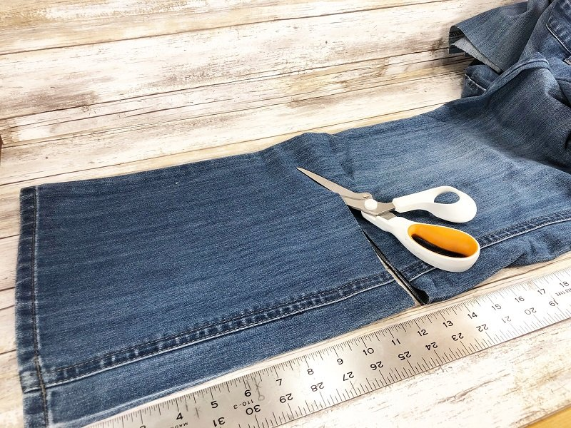 Measure and cut the jean legs to 12 inches and 14 inches Creatively Beth #creativelybeth #upcycle #recycle #denim #crafts #falldecor #pumpkins #autumndecor #diy