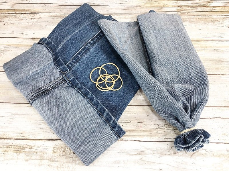 Turn jenas legs inside out and secure the first end with a tightly wrapped rubber band Creatively Beth #creativelybeth #upcycle #recycle #denim #crafts #falldecor #pumpkins #autumndecor #diy