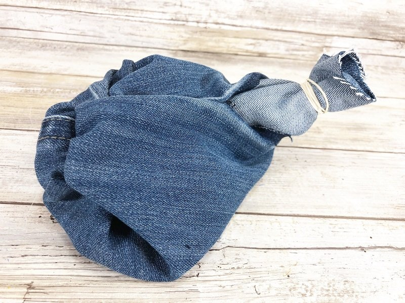 Turn denim pumpkin right side out through the hole created in the seam of the blue jeans Creatively Beth #creativelybeth #upcycle #recycle #denim #crafts #falldecor #pumpkins #autumndecor #diy