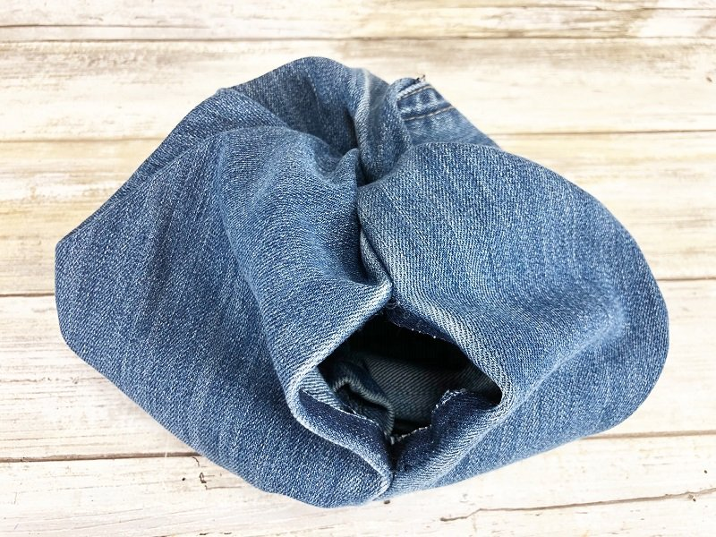 Once the pumpkin has been turned right side out find the hole created in the seam of the jeans Creatively Beth #creativelybeth #upcycle #recycle #denim #crafts #falldecor #pumpkins #autumndecor #diy