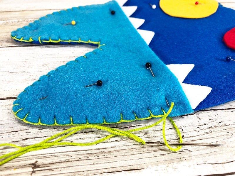 Blanket stitch three layers of felt together to create the monster Creatively Beth #creativelybeth #toothfairy #fairfieldworld #80daysofpolyfil #polyfil #felt #monster #craft