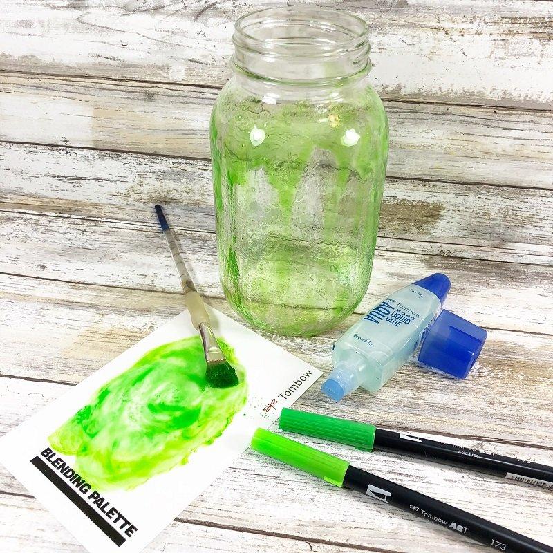 Mix Dual Brush Pen color and MONO Aqua Liquid Glue to create a tint for the mason jar Creatively Beth #creativelybeth #masonjar #witch #halloween #craft #creativecrafts