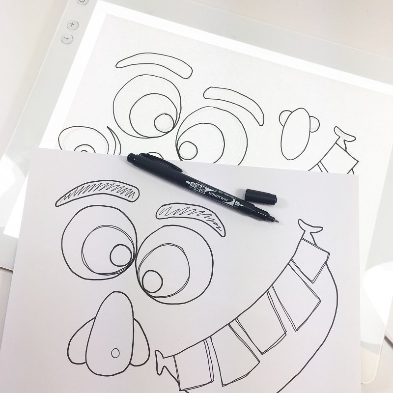 Place sketch onto the Cricut Bright Pad and trace monster facial features onto heavy cardstock with the MONOTWIN Permanent Marker Creatively Beth #creativelybeth #monsterpumpkins #nocarvepumpkins #freeprintable #kidscraft #halloweencraft