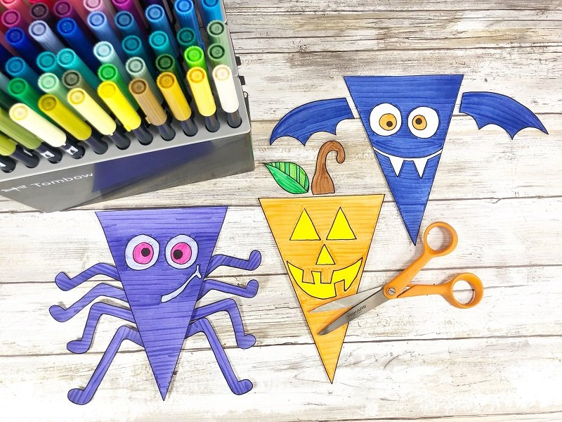 Cut out all banners and accessories from printable sheets with scissors Creatively Beth #creativelybeth #halloween #banner #freeprintable #coloring #handdrawn
