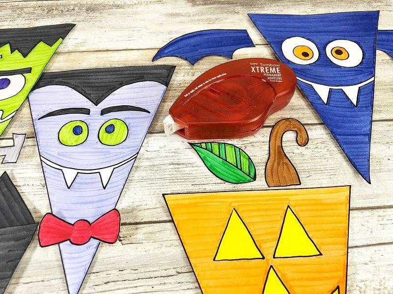Attach accessories to banners with Tombow Xtreme Permanent Adhesive Creatively Beth #creativelybeth #halloween #banner #freeprintable #coloring #handdrawn