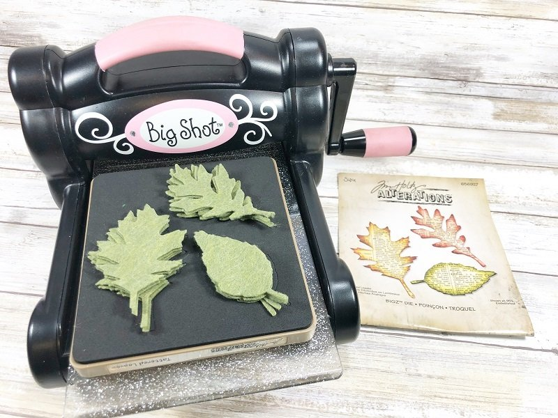 Cut out leaves with a die cutting machine and die Creatively Beth #creativelybeth #dollartreecrafts #halloweencrafts #pumpkincrafts #rainbowcrafts #createwithkunin