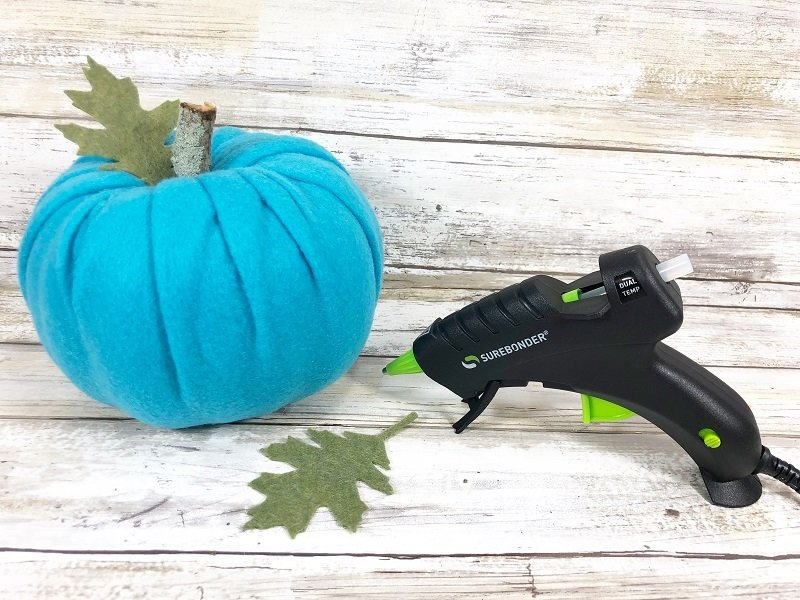 Attach branch stem and felt leaf to each pumpkin with a glue gun Creatively Beth #creativelybeth #dollartreecrafts #halloweencrafts #pumpkincrafts #rainbowcrafts #createwithkunin