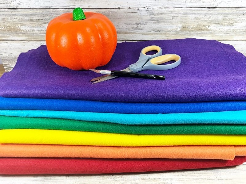 Materials needed to create Dollar Tree Rainbow Pumpkins Creatively Beth #creativelybeth #dollartreecrafts #halloweencrafts #pumpkincrafts #rainbowcrafts #createwithkunin