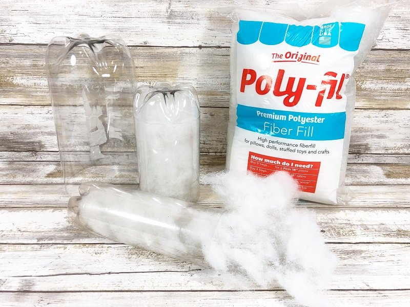 Stuff the plastic bottles with Poly-Fil from Fairfield World Creatively Beth #creativelybeth #creativecrafts #recycledcrafts #halloweencrafts