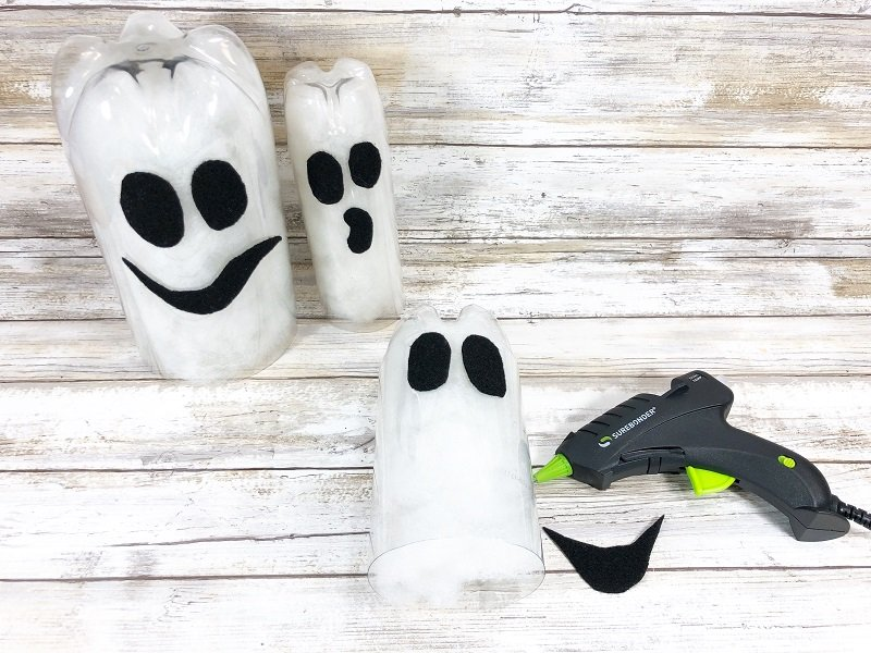 Attach ghost features with a low temp glue gun Creatively Beth #creativelybeth #creativecrafts #recycledcrafts #halloweencrafts