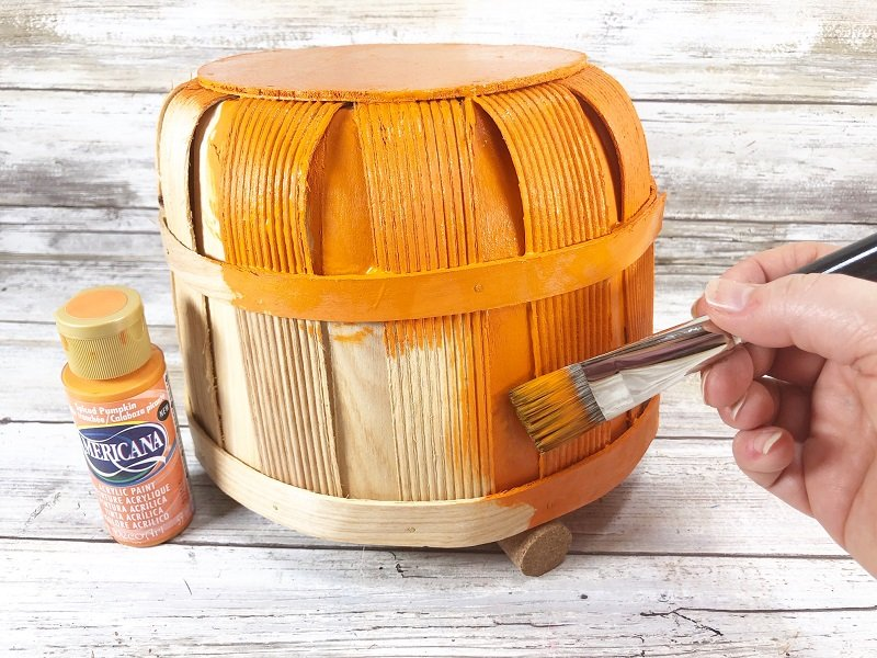 Basecoat the basket with spiced pumpkin acrylic paint Creatively Beth #creativelybeth #dollartree #craft #falldecor #bushelbasket #pumpkin #craft