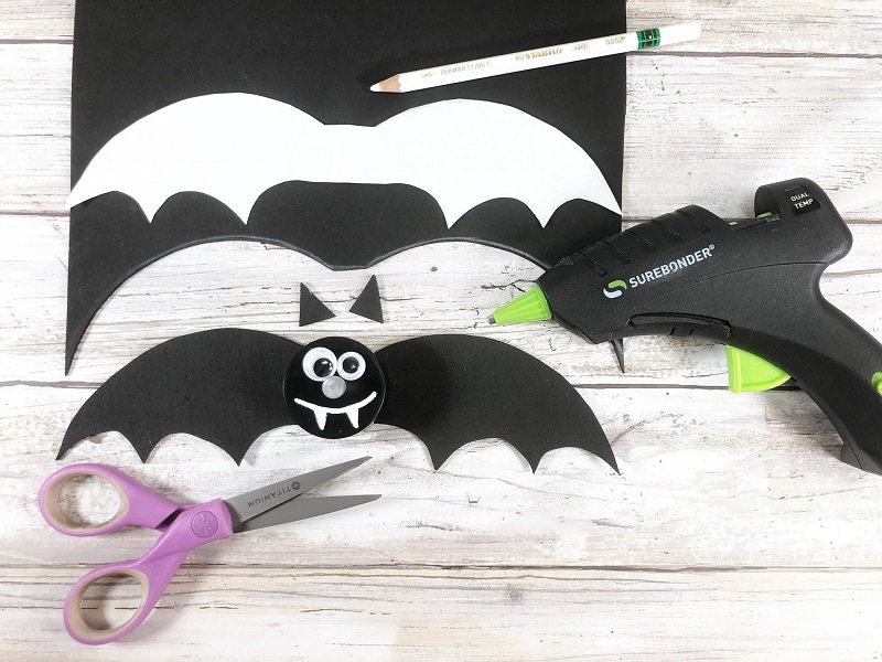 Trace and cut out bat patterns then attach to votive with hot glue Creatively Beth #creativelybeth #dollartree #crafts #halloween #ghost #bat #jackolantern
