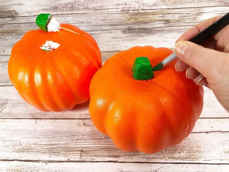 Using a craft knife cut a hole in the top of the foam pumpkin around the stem Creatively Beth #creativelybeth #dollartree #bandanacrafts #crafts #pumpkin #falldecor #autumndecor