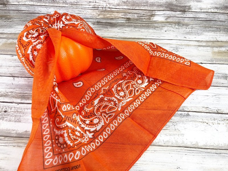 Continue to pull, gather and fold the bandana inserting the fabric in the hole Creatively Beth #creativelybeth #dollartree #bandanacrafts #crafts #pumpkin #falldecor #autumndecor