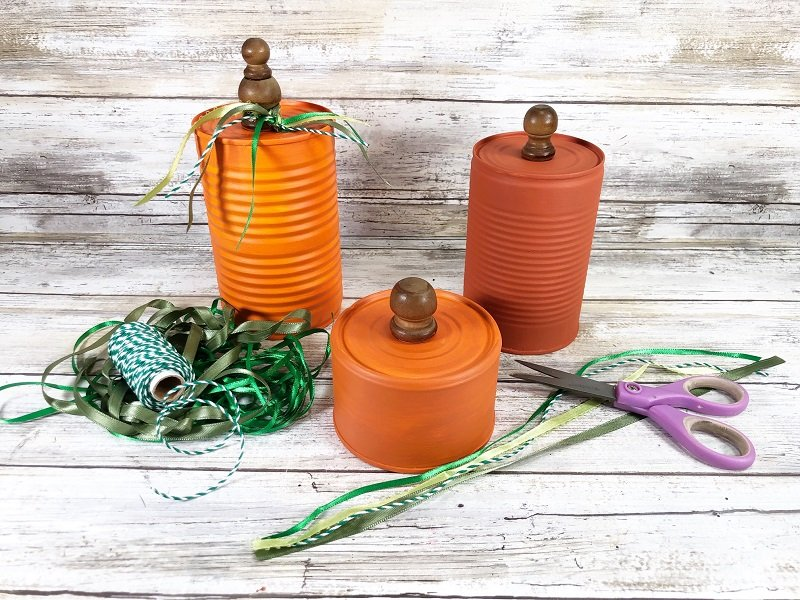 Tie on a variety of green ribbons and twines to the top of each tin can pumpkin Creatively Beth #CreativelyBeth #recycledcrafts #fallcrafts #pumpkincrafts #autumncrafts