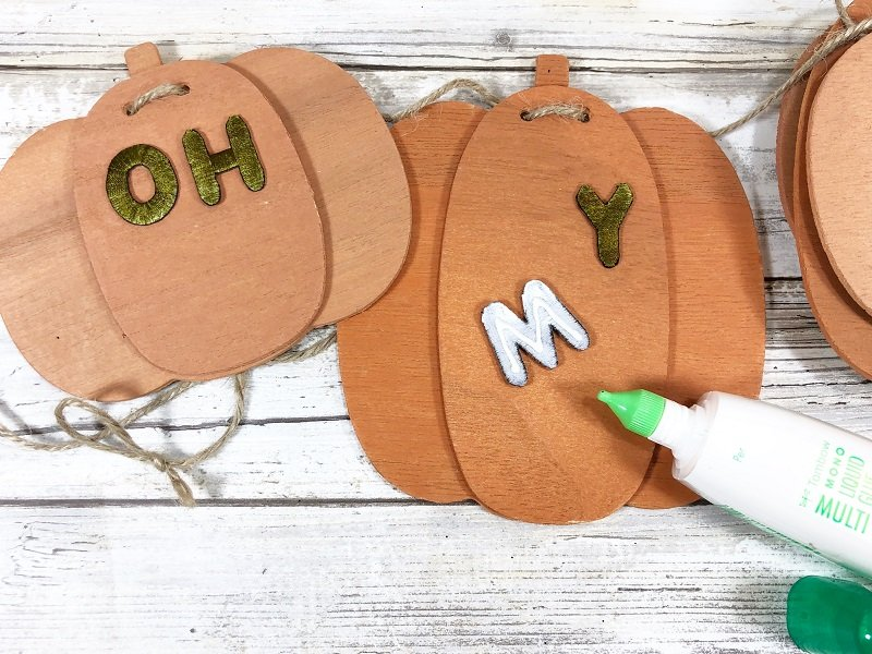 Glue small letters onto pumpkins with MONO Multi Liquid Glue Creatively Beth #creativelybeth #fall #garland #pumpkin #crafts #ohmygourd