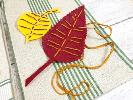 Stitch veins onto the felt leaf with embroidery floss and needle by Creatively Beth #creativelybeth #embroidery #handsewn #autumndecor #feltcrafts #fallleaves #easycrafts