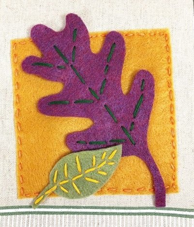 Stitch a square of goldenrod felt directly onto towel Creatively Beth #creativelybeth #embroidery #handsewn #autumndecor #feltcrafts #fallleaves #easycrafts