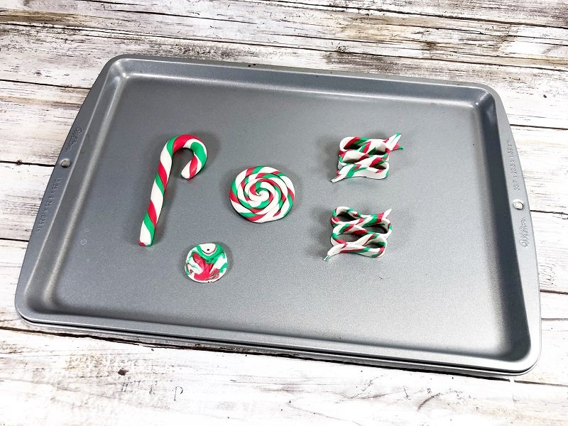 Place ornaments on a sheet pan and bake according to directions on the package Creatively Beth #creativelybeth #polymerclay #christmas #ornaments