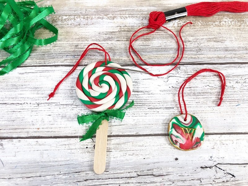 Tie a bow around the stick of the lollipop Creatively Beth #creativelybeth #polymerclay #christmas #ornaments