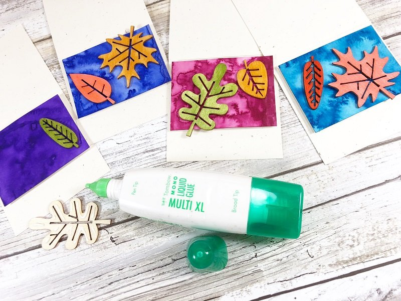 Color the wooden leaf shapes with Dual Brush Pens and attach with MONO Multi Liquid Glue Creatively Beth #creativelybeth #tombowdualbrushpens #watercolor #thanksgiving #placecards #craft