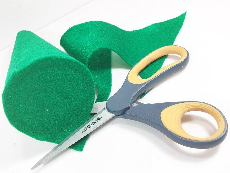 Add felt to bottom of foam cone and trim with scissors Creatively Beth #creativelybeth #craftstorehomedecor #feltcrafts #christmascrafts #christmasmantel #christmastree