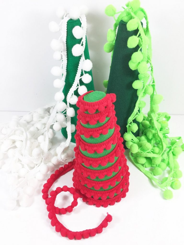 Fit trim around each cone to make sure you have enough Creatively Beth Easy DIY Felt Trees  #creativelybeth #craftstorehomedecor #feltcrafts #christmascrafts #christmasmantel #christmastree
