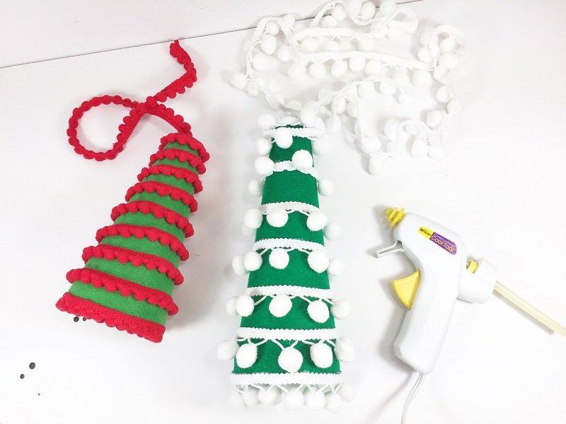 Attach trim to felt cone with low temp glue gun Creatively Beth #creativelybeth #craftstorehomedecor #feltcrafts #christmascrafts #christmasmantel #christmastree