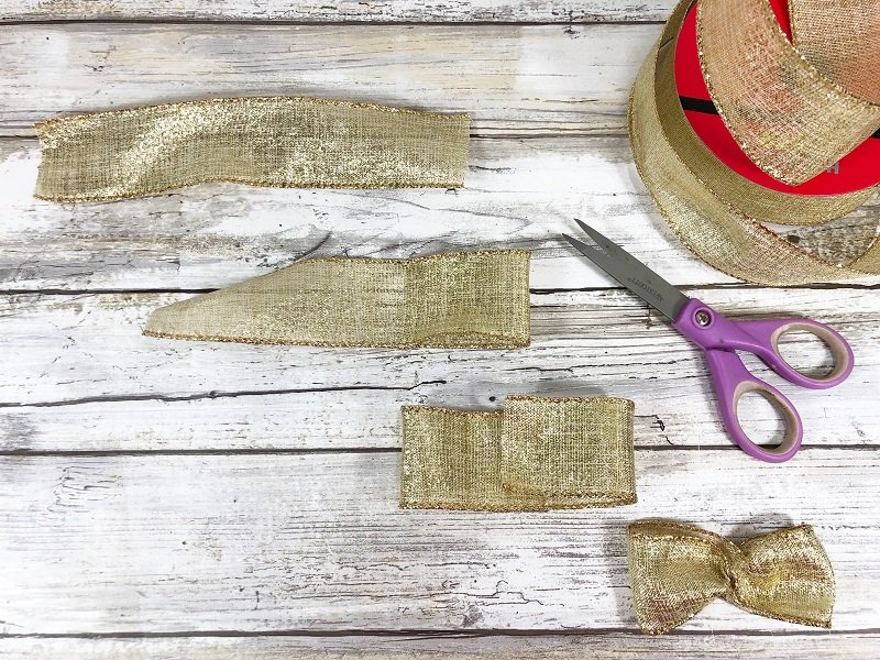 Make wings from gold wired ribbon Recycled Wine Cork Angel Ornament a 20 Minute Craft by Creatively Beth #creativelybeth #20minutecrafts #recycledcrafts #winecorkcrafts #angelcrafts