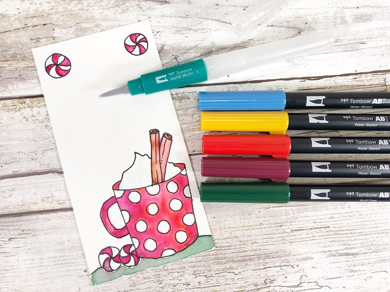 Use the Tombow Water Brush to move color around on Tags Creatively Beth #creativelybeth #freeprintable #holiday #tags #watercolor