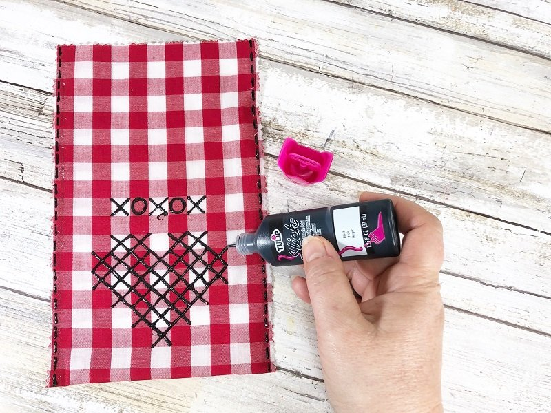 Draw cross stitch heart on the bags with dimensional fabric paint Creatively Beth #creativelybeth #crossstitch #valentinesdaycrafts #nosewcrafts #giftbags