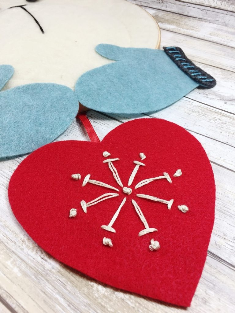 Embroider a Snowflake onto the red felt heart for the Polar Bear to hold Creatively Beth #creativelybeth #feltcraft #embroideryhoopwreath #winterwreath
