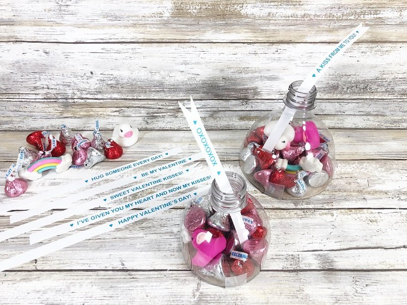 Insert Jumbo Kiss messages into the neck of the plastic bottle Creatively Beth #creativelybeth #valentinesday #hersheykiss #recycledcrafts