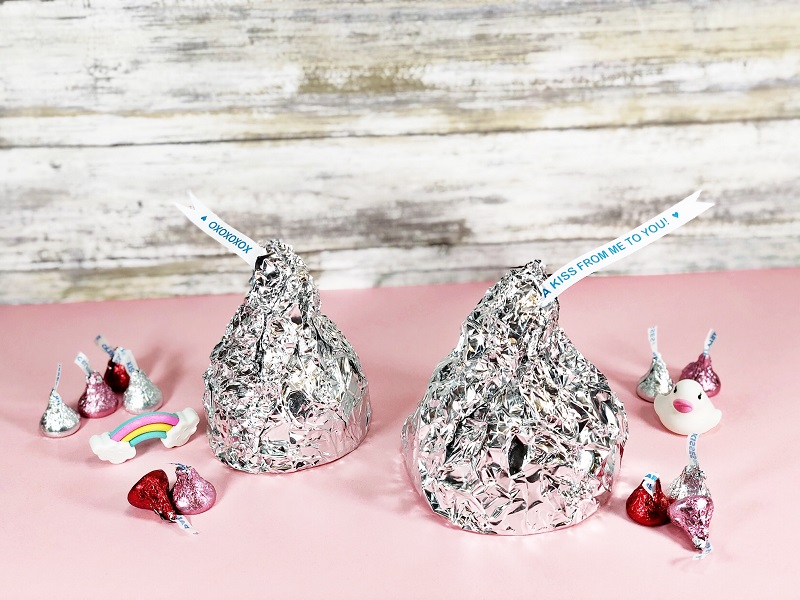 Create Jumbo Chocolate Kiss Containers for Valentine's Day by Creatively Beth #creativelybeth #valentinesday #hersheykiss #recycledcrafts