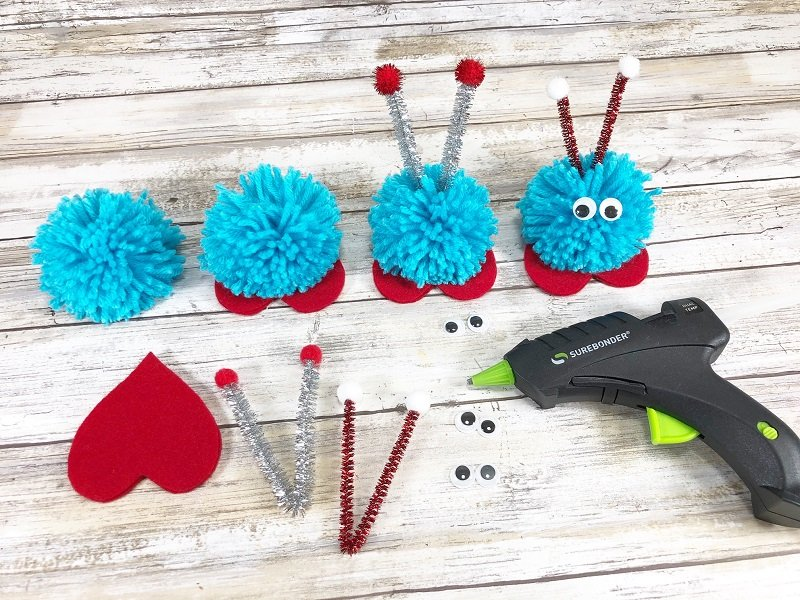 Assemble pom pom love bugs with glue gun Creatively Beth #creativelybeth #pompomcraft #lovebug #drseuss #catinthehat #thing1andthing2 #pompomcraft