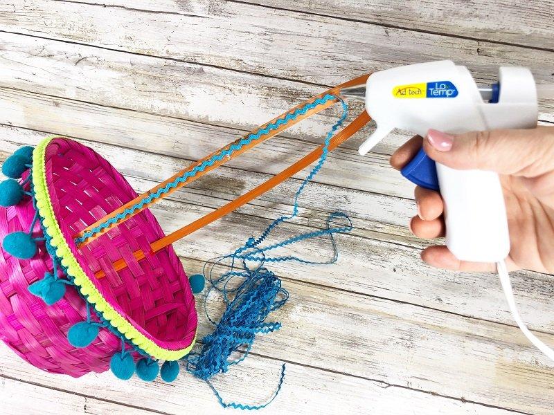 Glue Mini Rick Rack on handle of Easter basket Creatively Beth #creativelybeth #easterbasket #dollartree #boho