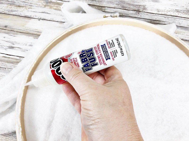 Secure batting to the back of the embroidery hoop with fabric glue Creatively Beth #creativelybeth #embroideryhoop #bunnycraft #fairfieldworld #polyfil #madewithFFW