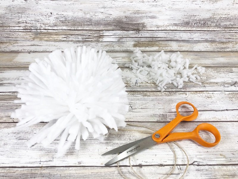 Trim the ragged ends of the giant pom pom with scissors Creatively Beth #creativelybeth #embroideryhoop #bunnycraft #fairfieldworld #polyfil #madewithFFW