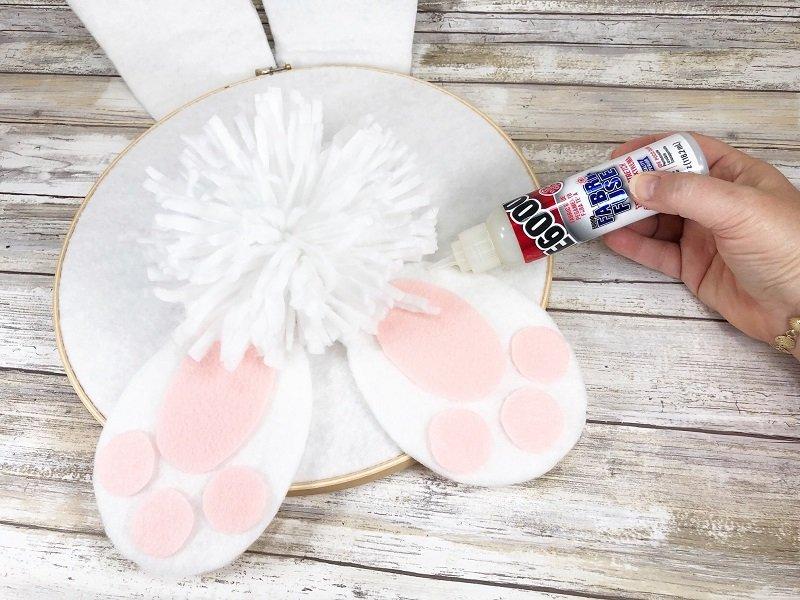 Glue on giant pom pom to create the Bunny tail Creatively Beth #creativelybeth #embroideryhoop #bunnycraft #fairfieldworld #polyfil #madewithFFW