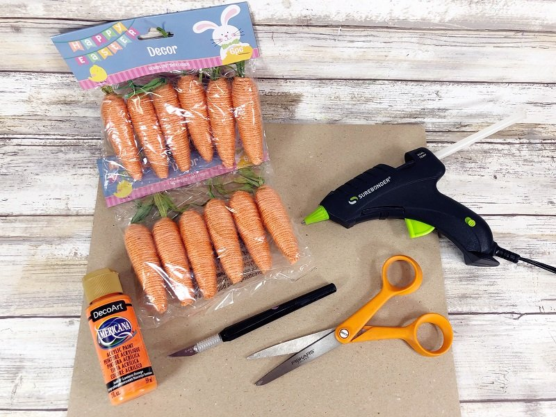 Materials needed for Dollar Tree Carrot Wreath by Creatively Beth #creativelybeth #dollartreecrafts #easterwreath #dollartreecarrots #springwreath