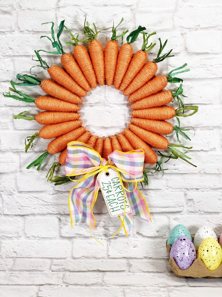 The Sweetest Dollar Tree Carrot Wreath for Easter by Creatively Beth #creativelybeth #dollartreecrafts #easterwreath #dollartreecarrots #springwreath