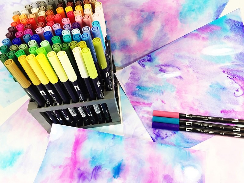 Mist and place injet paper glossy side down in wet ink Creatively Beth #creativelybeth #tombowdualbrushpens #watercolor #marbledpaper #watercolorbackgrounds