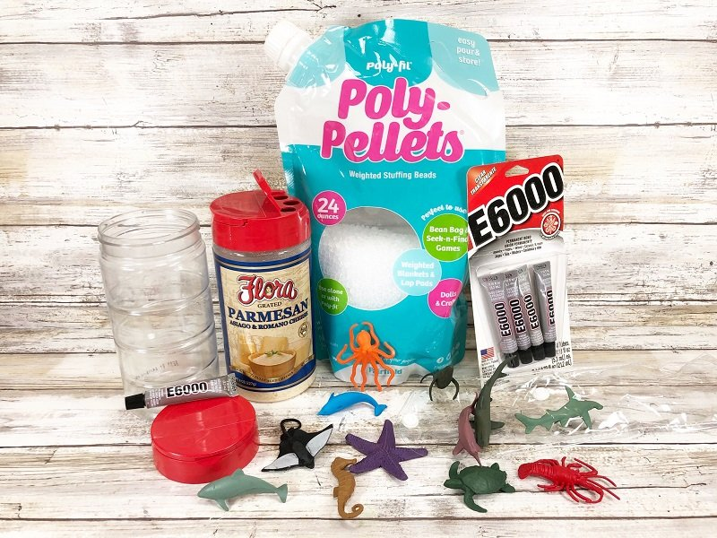 Materials needed to create an easy sensory bottle with Poly-Pellets from Fairfield World by Creatively Beth #creativelybeth #sensorybottle #freeprintable #wordsearch #doodles #madewithFFW