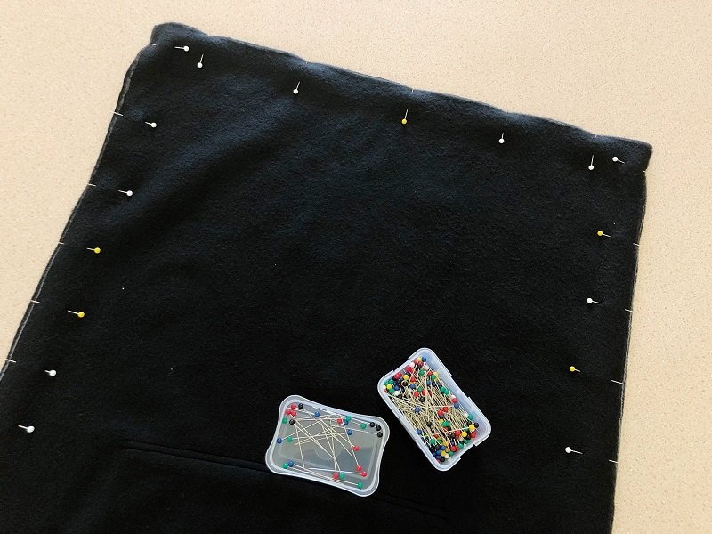 Secure the three cut edges with straight pins Creatively Beth #creativelybeth #upccyledcrafts #recycledcrafts #pillow #madewithFFW #sweatshirtpillow #hoodiepillow